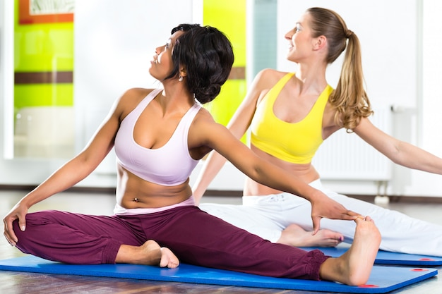 Women in the gym doing yoga exercise for fitness Premium Photo