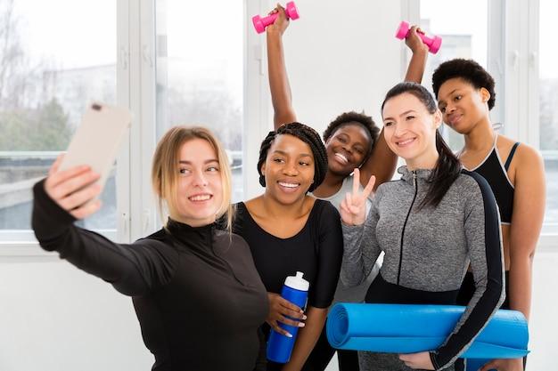 Women at gym taking photos Free Photo