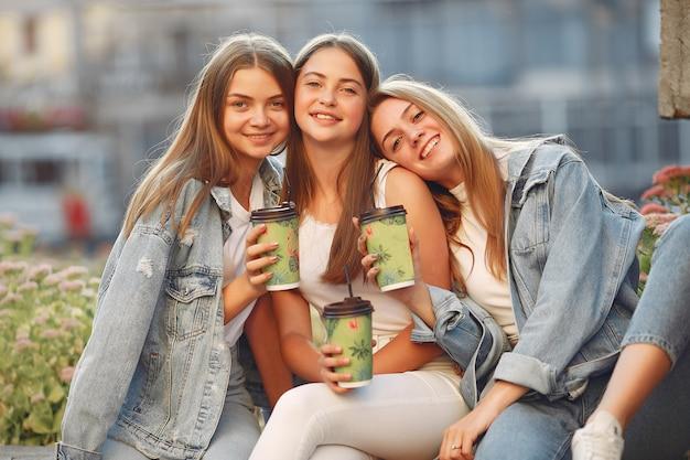 Women having fun in the street taking a coffee Free Photo