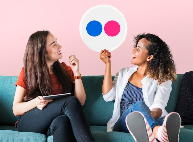 Women holding a Flickr icon Free Photo