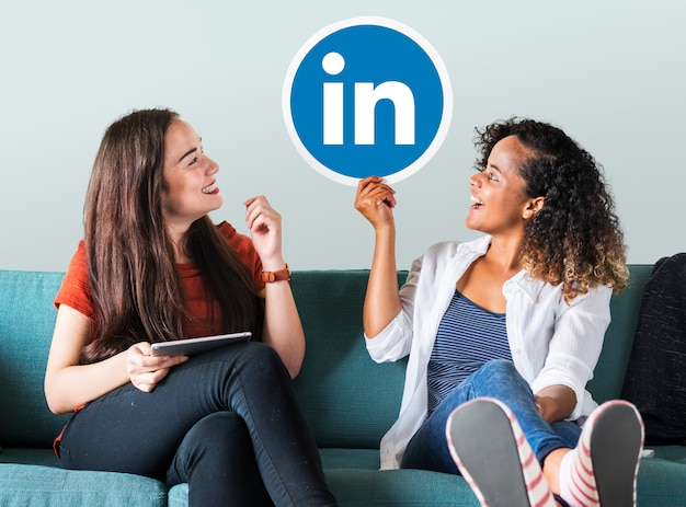 Women holding a linkedin logo Free Photo