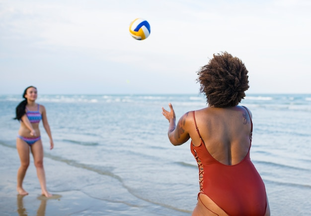 Women playing volleyball on the beach Premium Photo