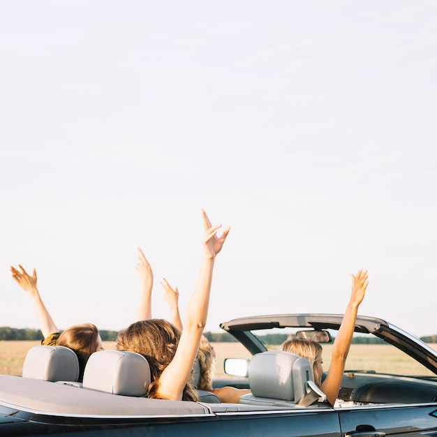 Women riding car Free Photo