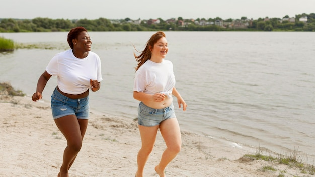 Women running together at the beach Free Photo