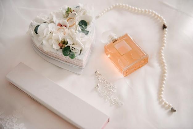 Women's accessories bride. handbag, shoes, rings, bridal perfume Premium Photo