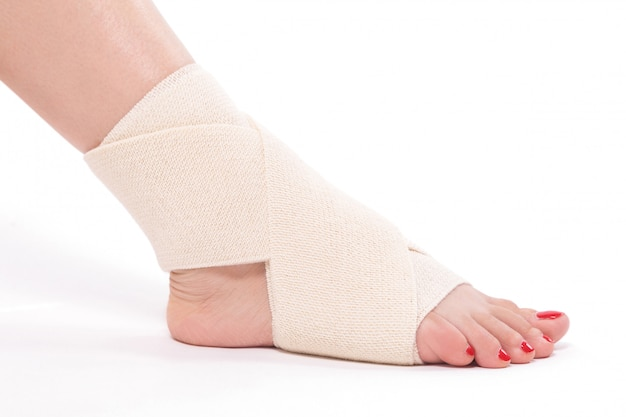 Women's ankle tied with an elastic bandage Premium Photo