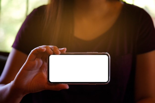 Women's hands holding cellphone blank screen forward for copy space screen Premium Photo