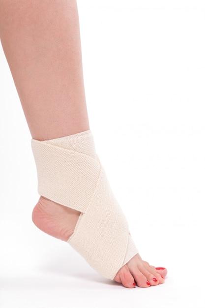 Women's leg tied with an elastic bandage Premium Photo