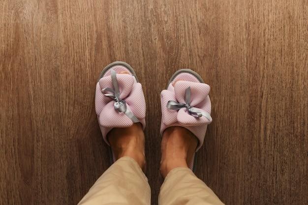 Women's legs in cozy beautiful slippers Premium Photo