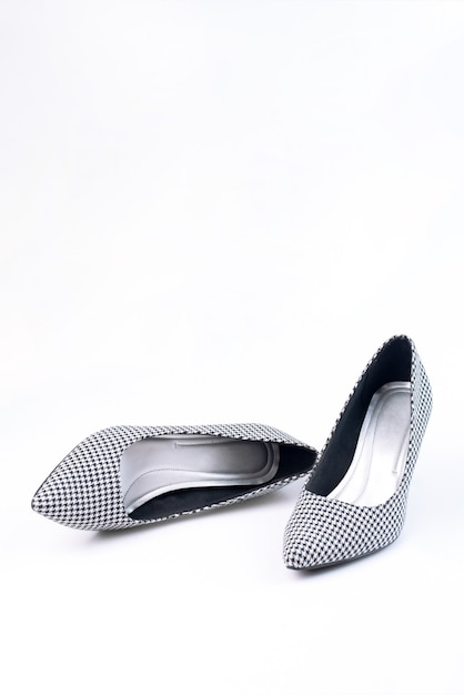 Premium Photo Women S Retro Shoes With Black And White Pattern On Heels Isolated On A White