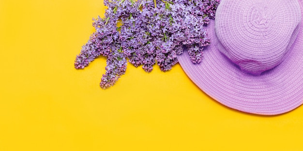 Women s summer pink hat and a bouquet of lilac flowers blossom Premium Photo