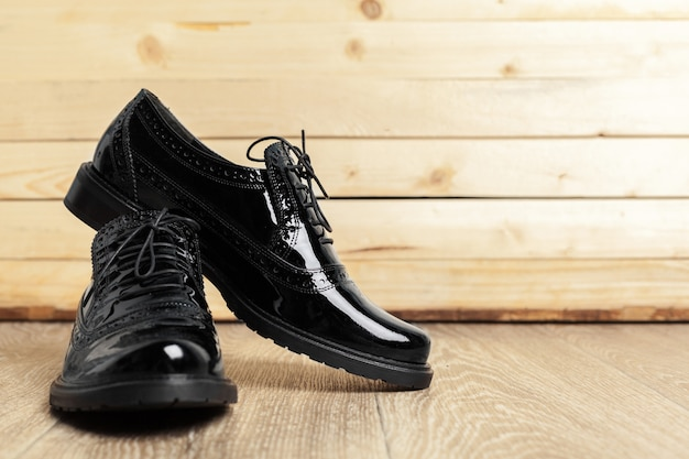 Women shoes on wooden background Premium Photo