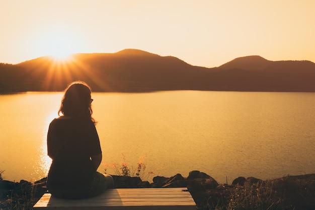 A women sitting alone Premium Photo