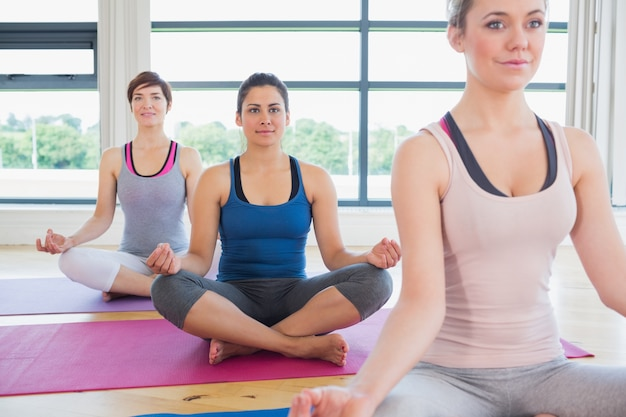 Women sitting in easy yoga pose Premium Photo