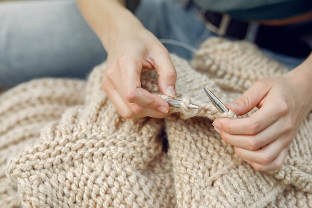 Women sitting in a summer park and knitting Free Photo