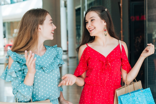 Women smiling at each other Free Photo