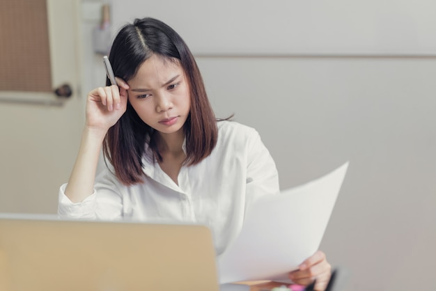 Women stressed because of computer use for a long time. the concept of overwork is bad for health. Premium Photo