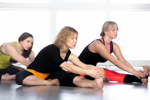 Women stretching in yoga class Free Photo