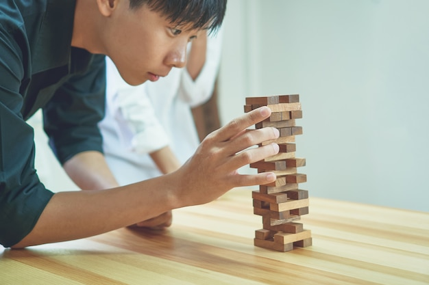 Women and teamwork making a pyramid with empty wooden cubes. Premium Photo