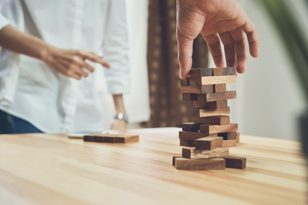 Women and teamwork making a pyramid with empty wooden cubes Premium Photo