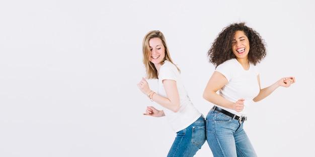 Women touching buttocks while dancing Free Photo