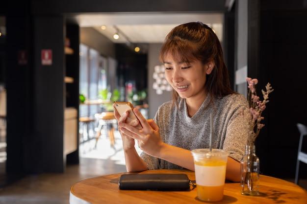 Women use smart phone in coffee cafe Premium Photo