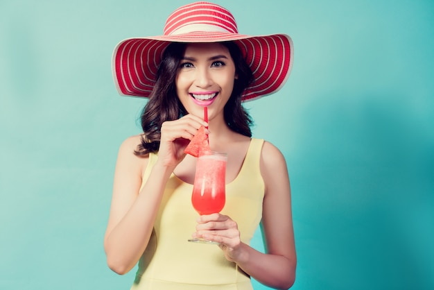 Women wear dresses. she was drinking watermelon smoothie in the summer she feels refreshed. Premium Photo