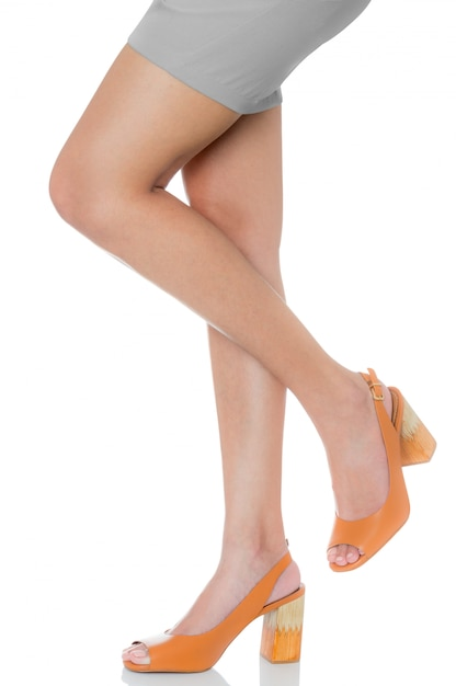 Women wearing leather chunky high heel fashion shoes posing lift her leg with front side view profile Premium Photo