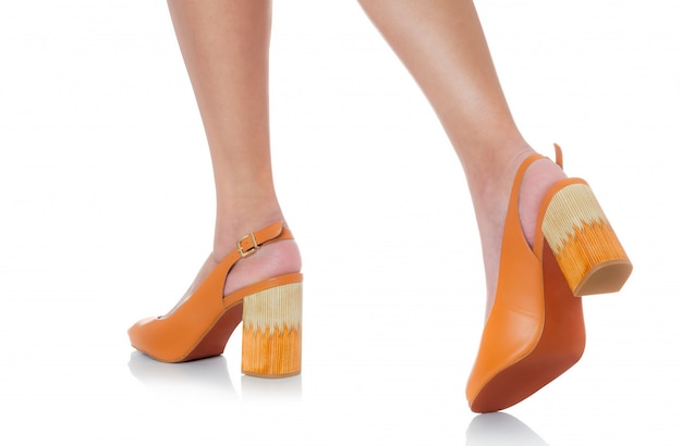 Women wearing leather chunky high heel fashion shoes stepping with backside view profile isolated on white Premium Photo