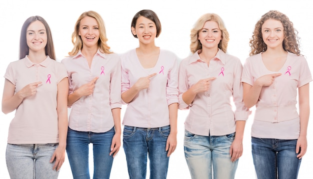Women wearing pink ribbons to support breast cancer campaign Premium Photo