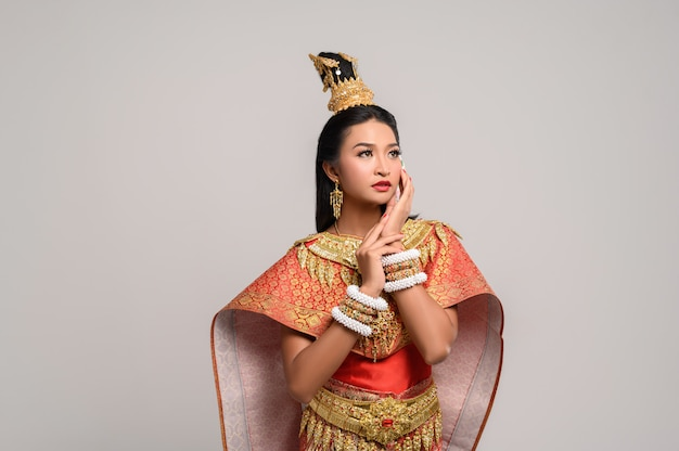 Women wearing thai clothes and hands touching their faces Free Photo