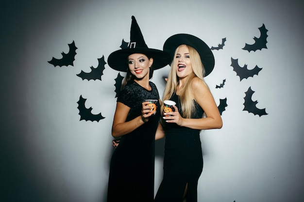 Women with cups on halloween party Free Photo