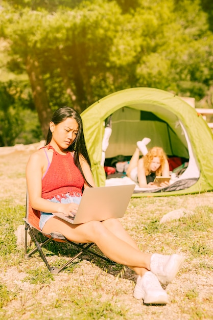 Women with gadgets resting outdoors Free Photo