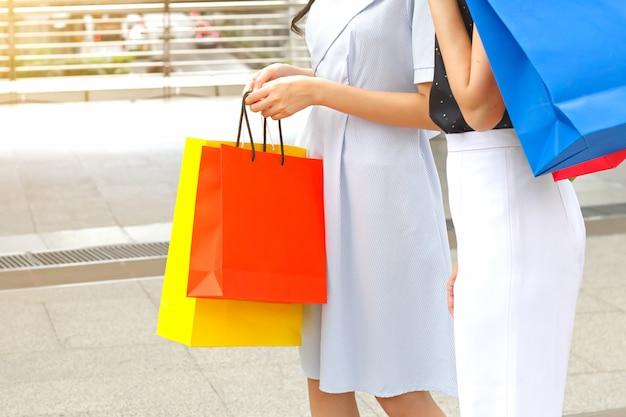 Women with shopping bags walking on sky walk Premium Photo