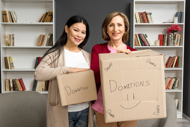 Womens with donation boxes Free Photo
