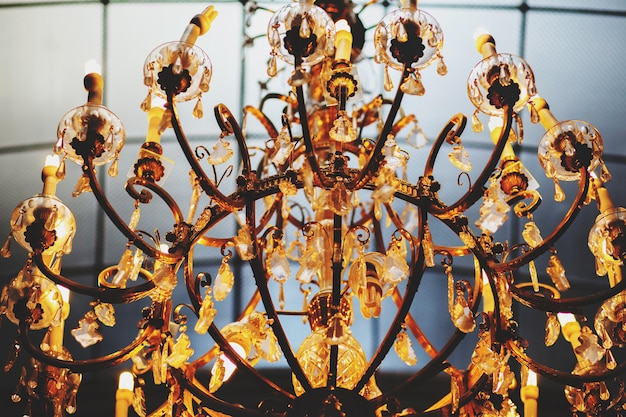 A wonderful old gold vintage chandelier decorated with crystals Free Photo