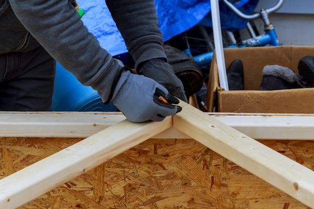 Wood battens of modern building closeup of a carpenter's hands Premium Photo
