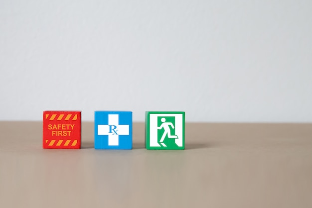 Wood block stacking with fire and safety icons. Premium Photo