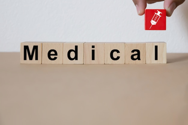 Wood block stacking with medical and health concept. Premium Photo