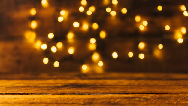 Wood board near fairy lights Premium Photo