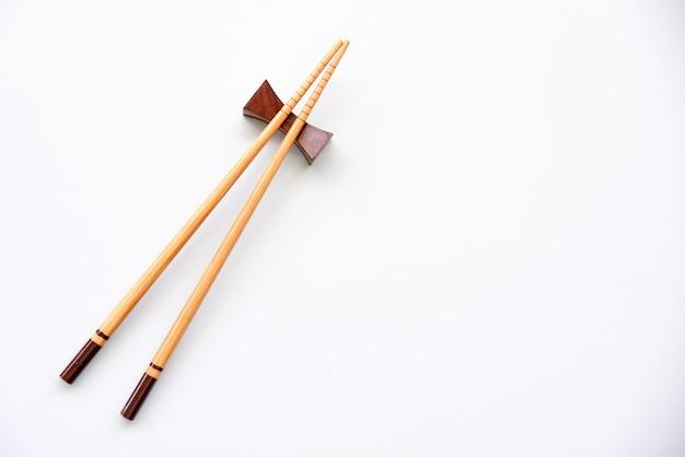 Wood chopsticks on white background copy space. Premium Photo