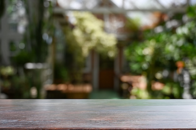 Wood desk in garden background with empty table. Premium Photo
