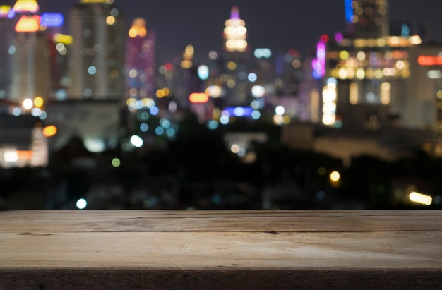 Wood floor with blurred abstract background of city night ...