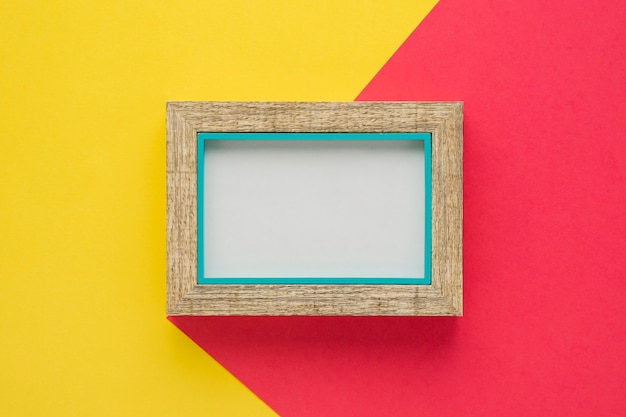 Wood frame with bicolor background Free Photo