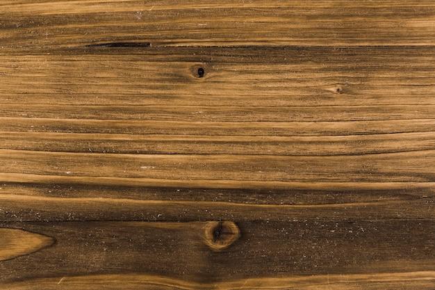 Superficie venatura del legno con nodi Foto Gratuite