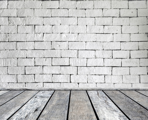 Wood plank gray on brick wall Premium Photo