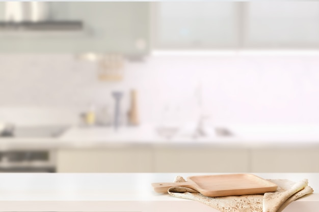 Wood plate on white table in kitchen room background and copy spce Premium Photo