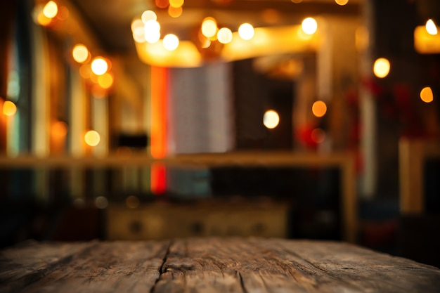 Wood table on blur background of club or restaurant Premium Photo