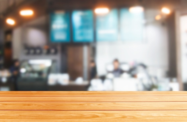 Wood table in blur background of modern restaurant Premium Photo
