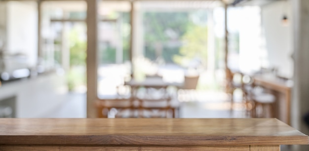 Wood table in cafe for products display montage Premium Photo